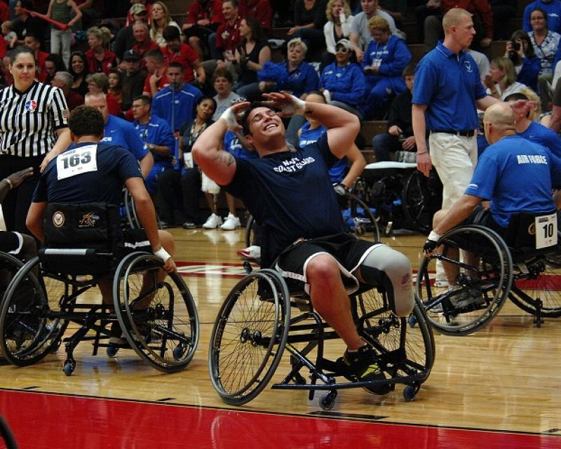 men playing sport in wheel chairs
